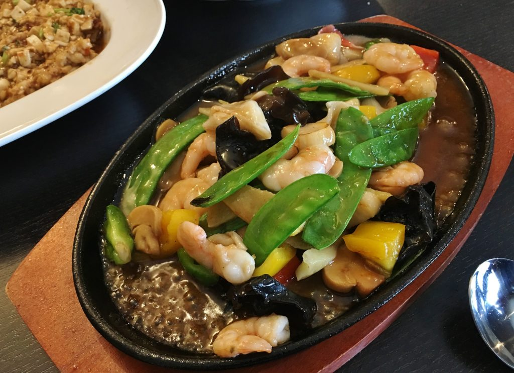 Seafood worbar on sizzling platter